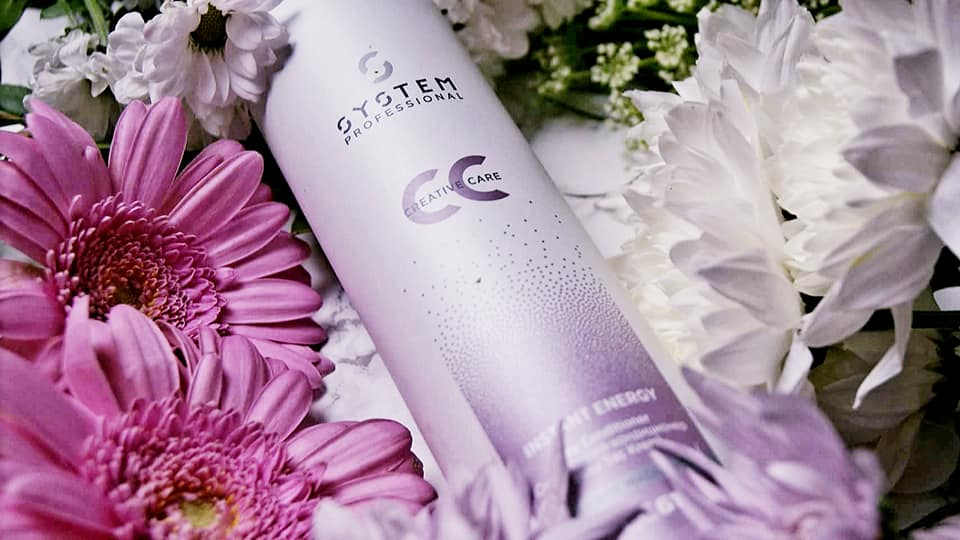 dry conditioner with flowers scattered around the bottle