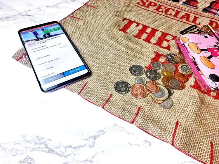 coins on a santa sac with phone