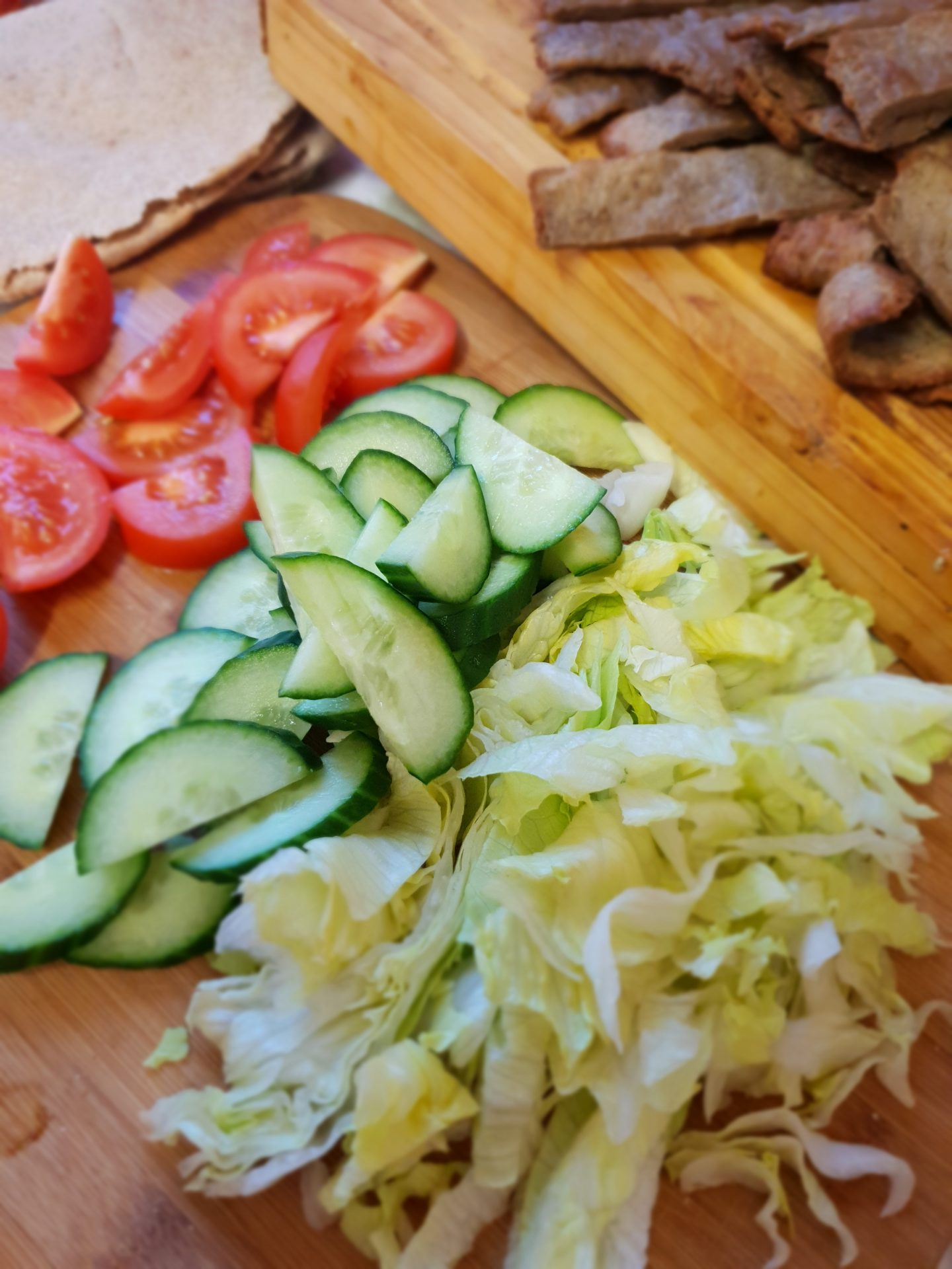 Doner kebab meat with shredded lettuce, cucumber and tomatoes.