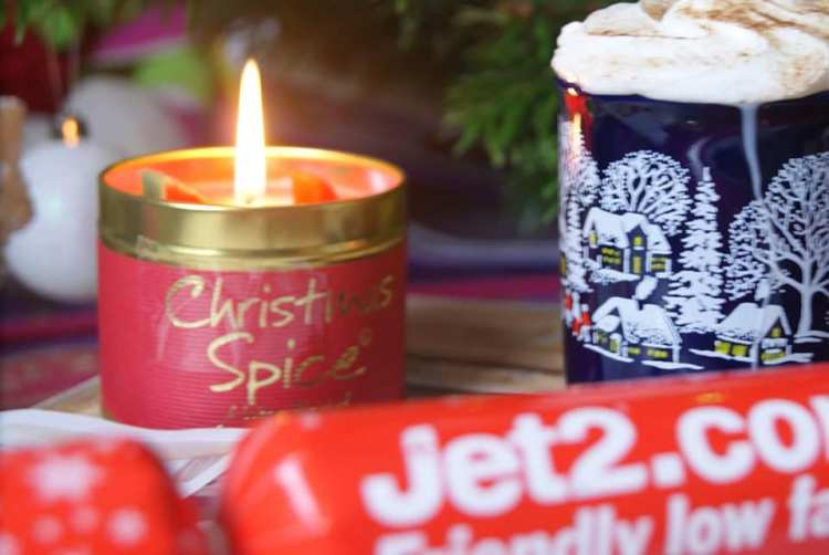 Candle with cracker and hot chocolate