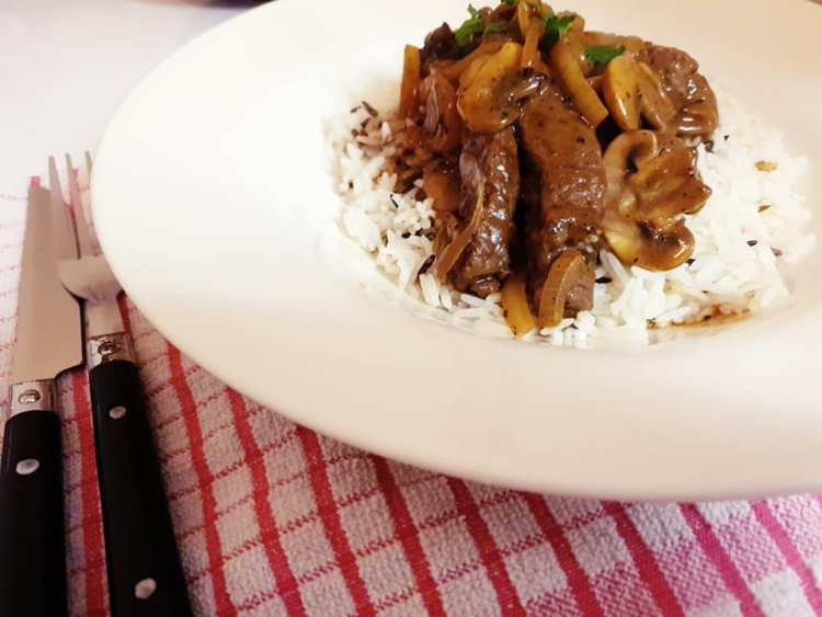 beef stroganoff on a bed of rice