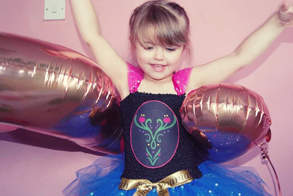 Shaniah in an anna dress inside a number 5 ballon.