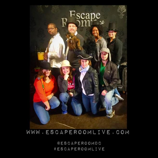 Team Disturbed Friends (Aaron, Mike, Shanell, Jess, Dalia, Chris, JoAnne and Jason) found the historian and the lost manuscript! Photo courtesy of Escape Room Live Alexandria's Facebook page.