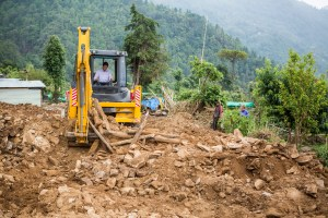 Gary Young on the backhoe clearing debris in Nepal