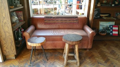 leather plus vintage textiles plus natural wood the estate of things