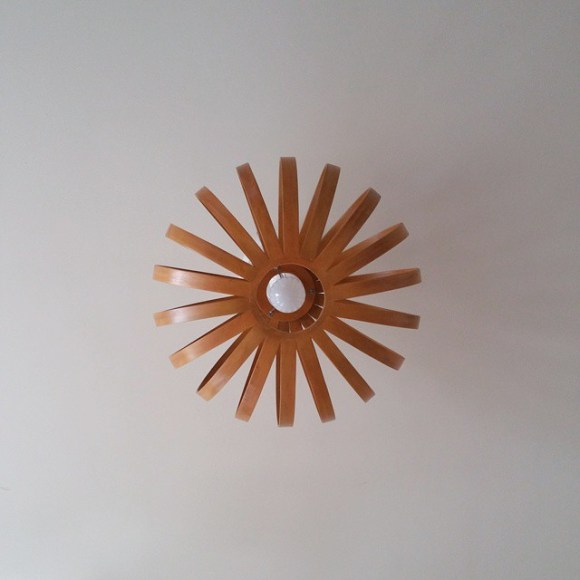 Dead_below_the_light_fixture_in_the__heffehouse_dining_room._I_like_to_lie_here_and_stare_up_at_this_shape_and_feel_thankful_that_we_upgraded_from_the_home_s_original_medieval_chandelier