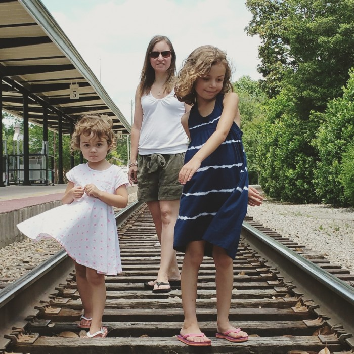 Sarah and her girls on the train tracks in their hometown, Southern Pines, NC