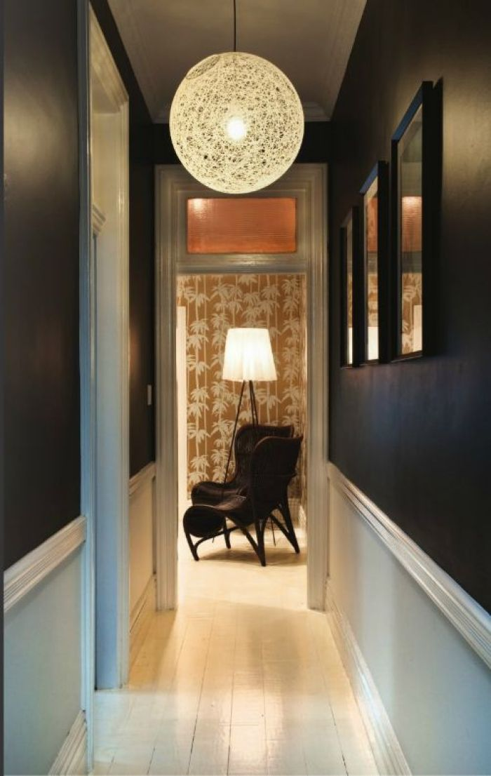 black wall hallway with chair rail
