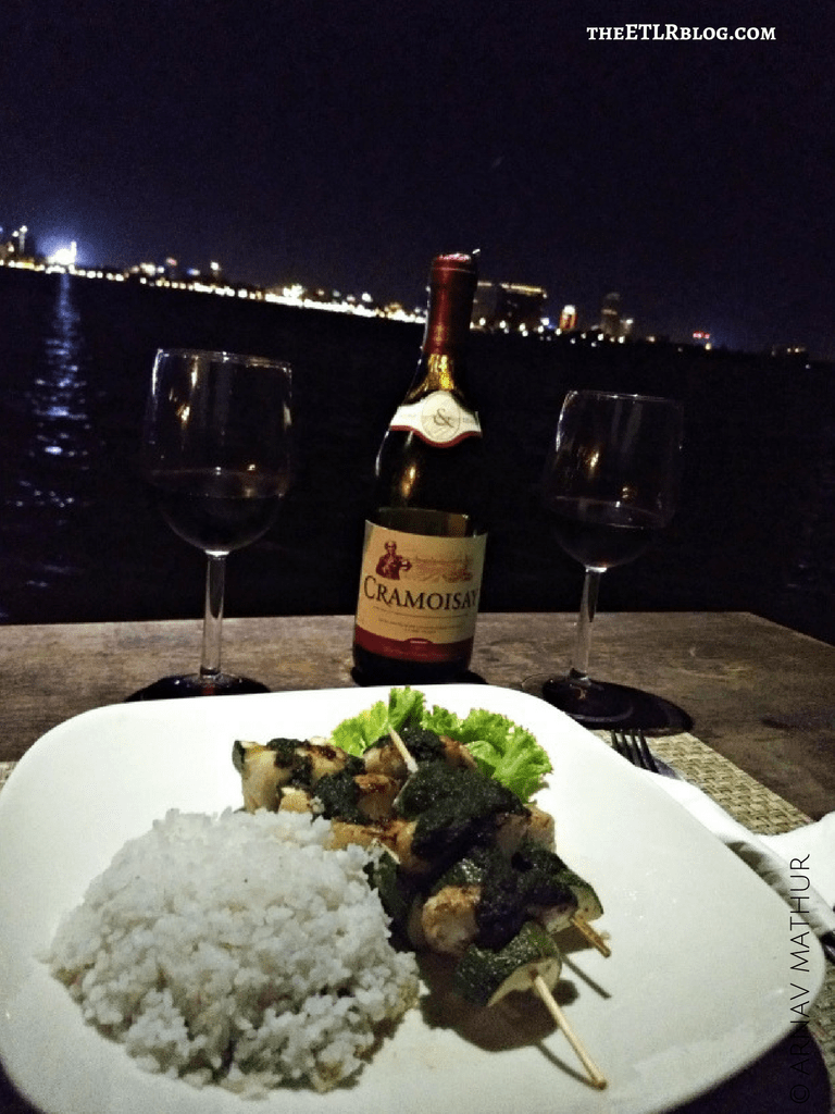 Dinner Time over looking the Phnom Penh skyline Cambodia MAADS