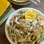 Asparagus and Leek Lemon Pasta is a family friendly recipe that you can have on the table in half an hour. This no frills weeknight dinner has simple, spring flavors and stays skinny with whole wheat pasta and a light cheese sauce. | theeverykitchen.com