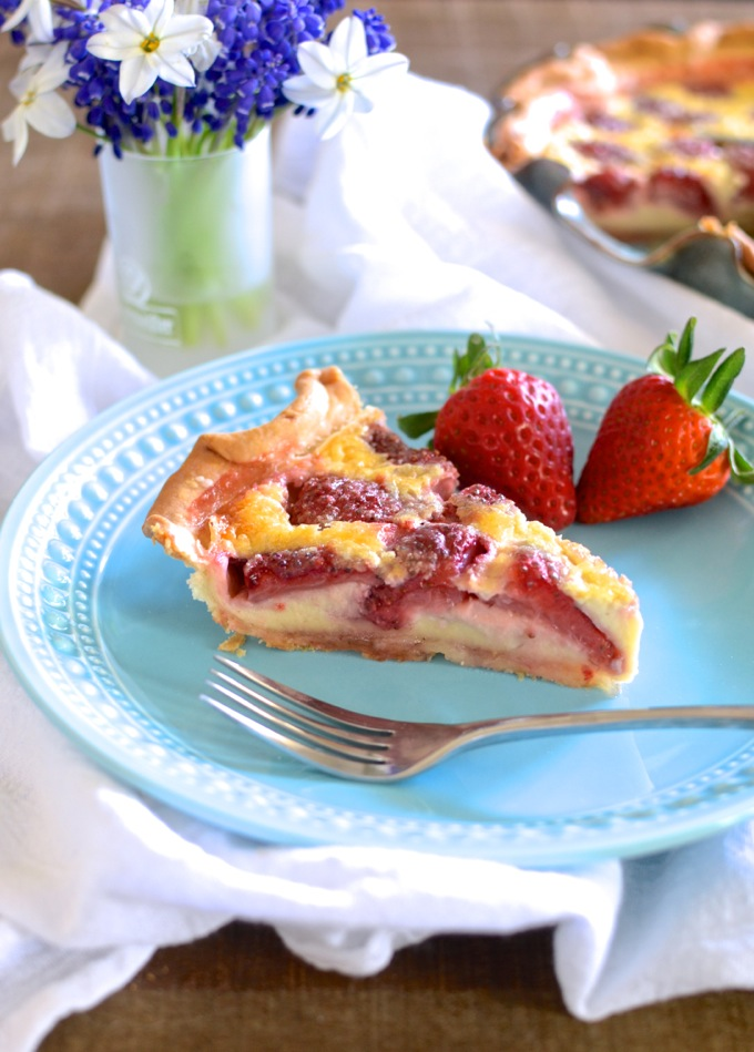 Strawberry Lemon Buttermilk Pie is a traditionally Southern recipe. The flavor is spot-on -- noticeably tart, but not over-powering. The crust is just what it should be -- flaky and crisp layered with soft and buttery. And it's perfectly accompanied by sweet whipped cream. | theeverykitchen.com