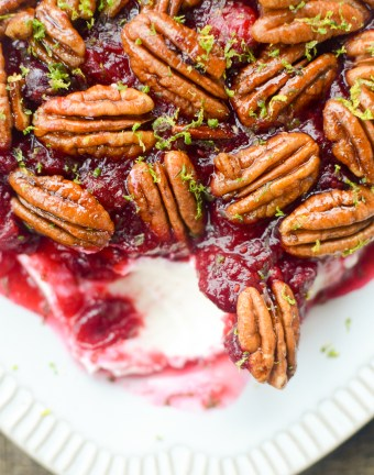 Cranberry Cream Cheese Dip with Candied Pecans is the perfect appetizer recipe for all your fall gatherings. It takes just 10 minutes to prep and makes enough to feed a crowd. #glutenfree #appetizer #holidayrecipe   theeverykitchen.com