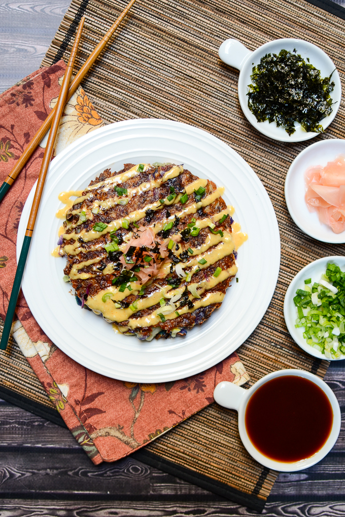 Known as Japanese comfort food, okonomiyaki is a savory Japanese cabbage pancake that is all at once sloppy, crispy, gooey, savory, sweet, and umami. | theeverykitchen.com