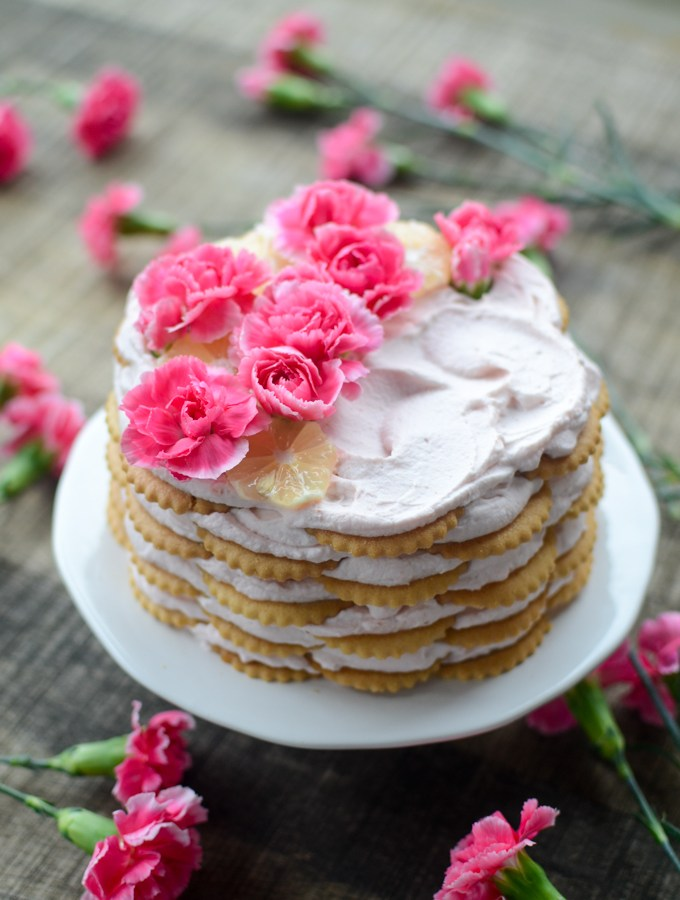 Close your eyes and imagine eating a slice of Pink Lemonade Icebox Cake. Lightly lemon cookies, soft between layers of luscious whipped cream, crispy edges, the taste of butter that lingers on your tongue. Make the recipe this morning, enjoy it this afternoon. | theeverykitchen.com
