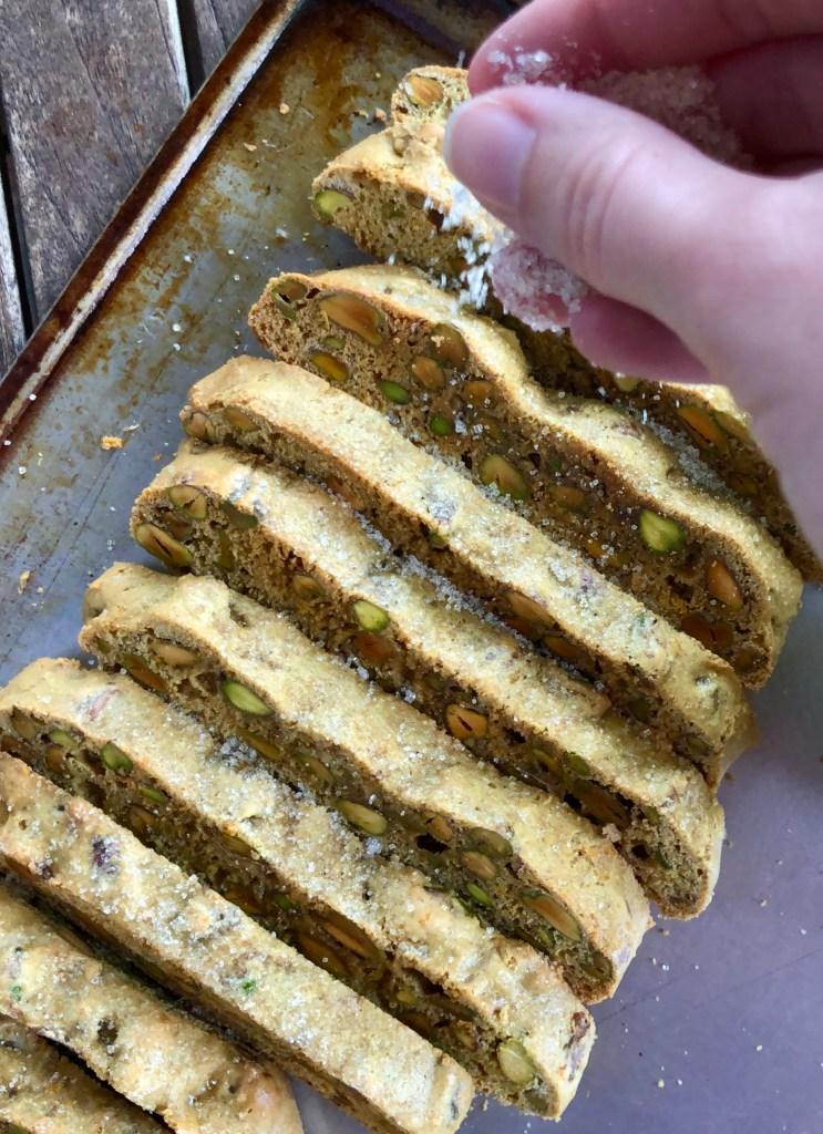 Toasted Pistachio Orange Biscotti is well-balanced with citrus notes. Toasty, a-little-bit-salty pistachios really steal the show. This recipe pairs well with a large pot of coffee. | theeverykitchen.com