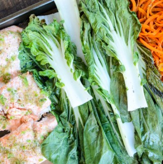 My recipe for Sheet Pan Salmon, Bok Choy, and Sweet Potato Noodles takes only 20 minutes, start to finish. Tender, buttery, perfectly prepared salmon will make you salivate before it melts in your mouth. | theeverykitchen.com