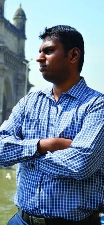 Vishal Chaudhari, founder of Wingage, stands at the Gateway of India. (Photo: Sierra Bein)