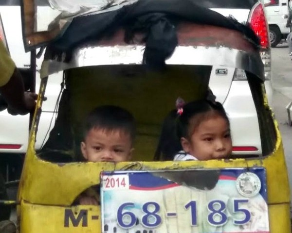 two Filipino children in a tricycle