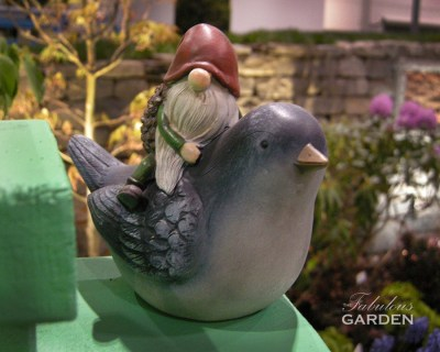 garden gnome on ceramic bird