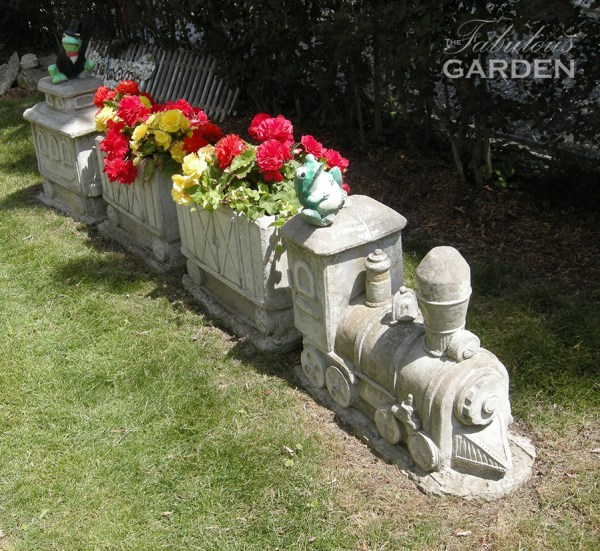 cement train driven by ceramic frog, containing red begonias