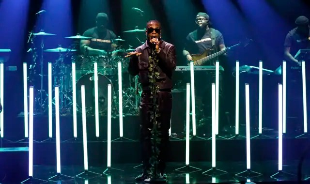 """Watch Burna Boy perform """"Collateral Damage"""" and """"Anybody"""" on Fallon 1"""