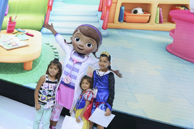 "D23 EXPO - Doc from Disney Junior's imaginative animated series ""Doc McStuffins"" steps out to make her official debut and greet young fans at Disney's D23 Expo, the ultimate event for Disney fans at the Anaheim Convention Center in Anaheim, California (August 11). (D23 EXPO/Matt Petit) DOC MCSTUFFINS"