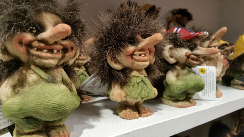 Norwegian Trolls in a store, choose a souvenir for a friend