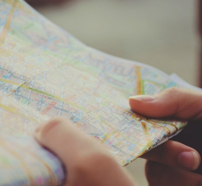 map, tourist, frugal road trip tips