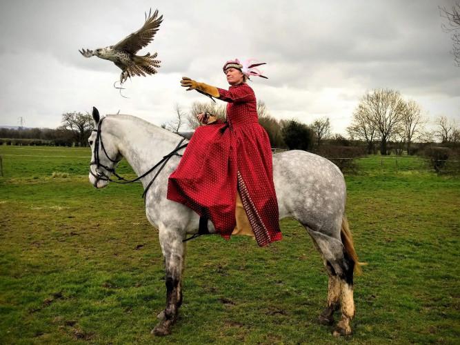 Falconry lady on horseback
