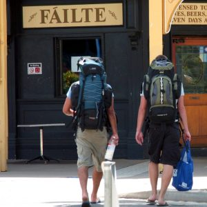Tourists walk with backpacks