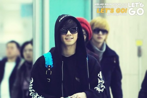 GO at the airport in hoodie