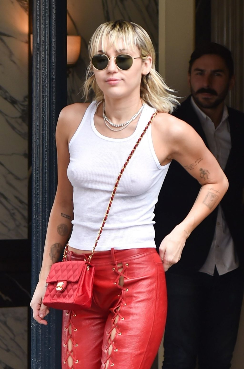 Braless Miley Cyrus is Red Hot in Leather Lace Up Biker Pants with a Tank Top (60 Photos)