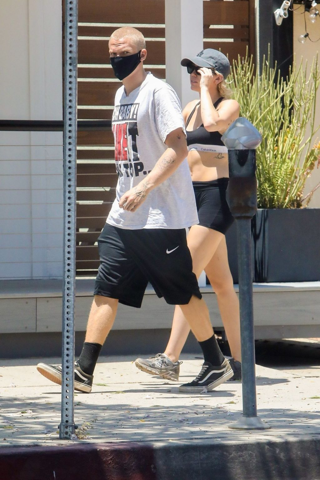 Miley Cyrus & Cody Simpson Walk with Their Dog (10 Photos)