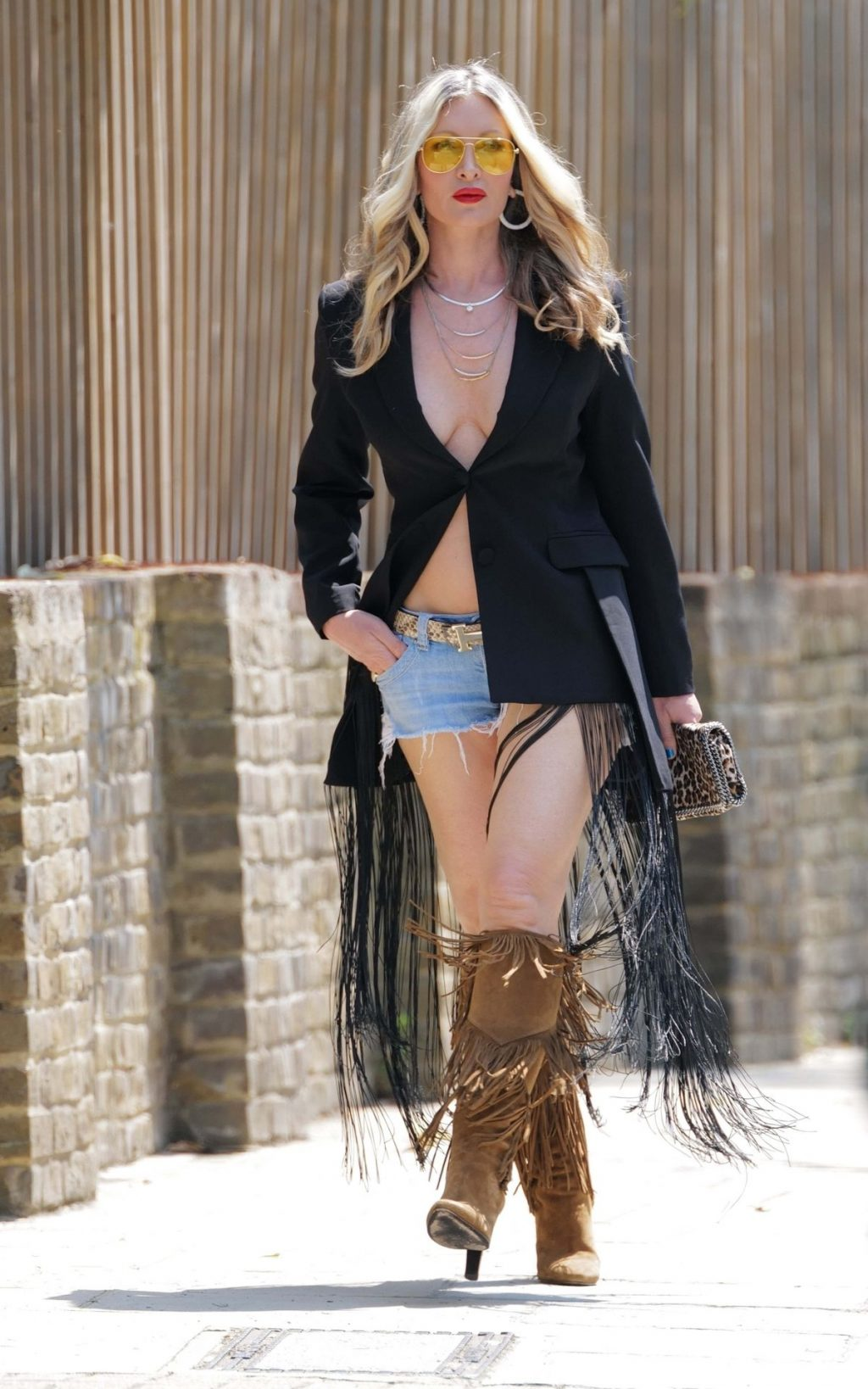 Caprice Wears a Plunging Blazer Jacket and Daisy Dukes in West London (16 Photos)