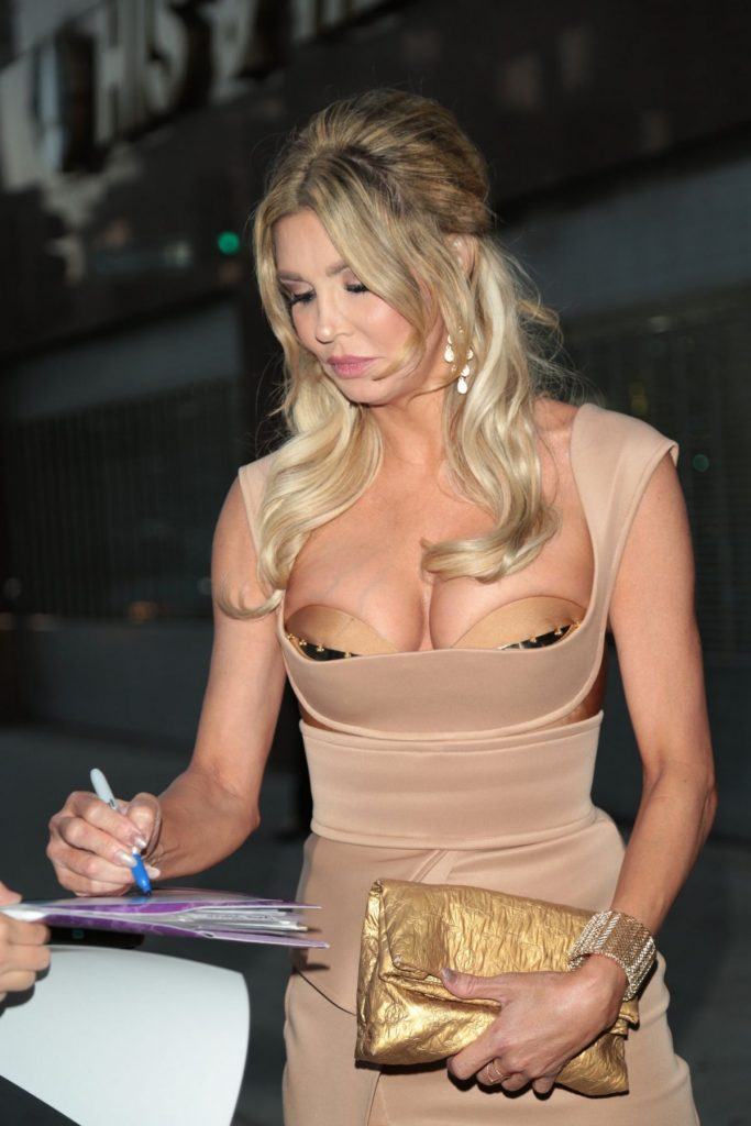 Brandi Glanville Almost Busting Out Of That Dress