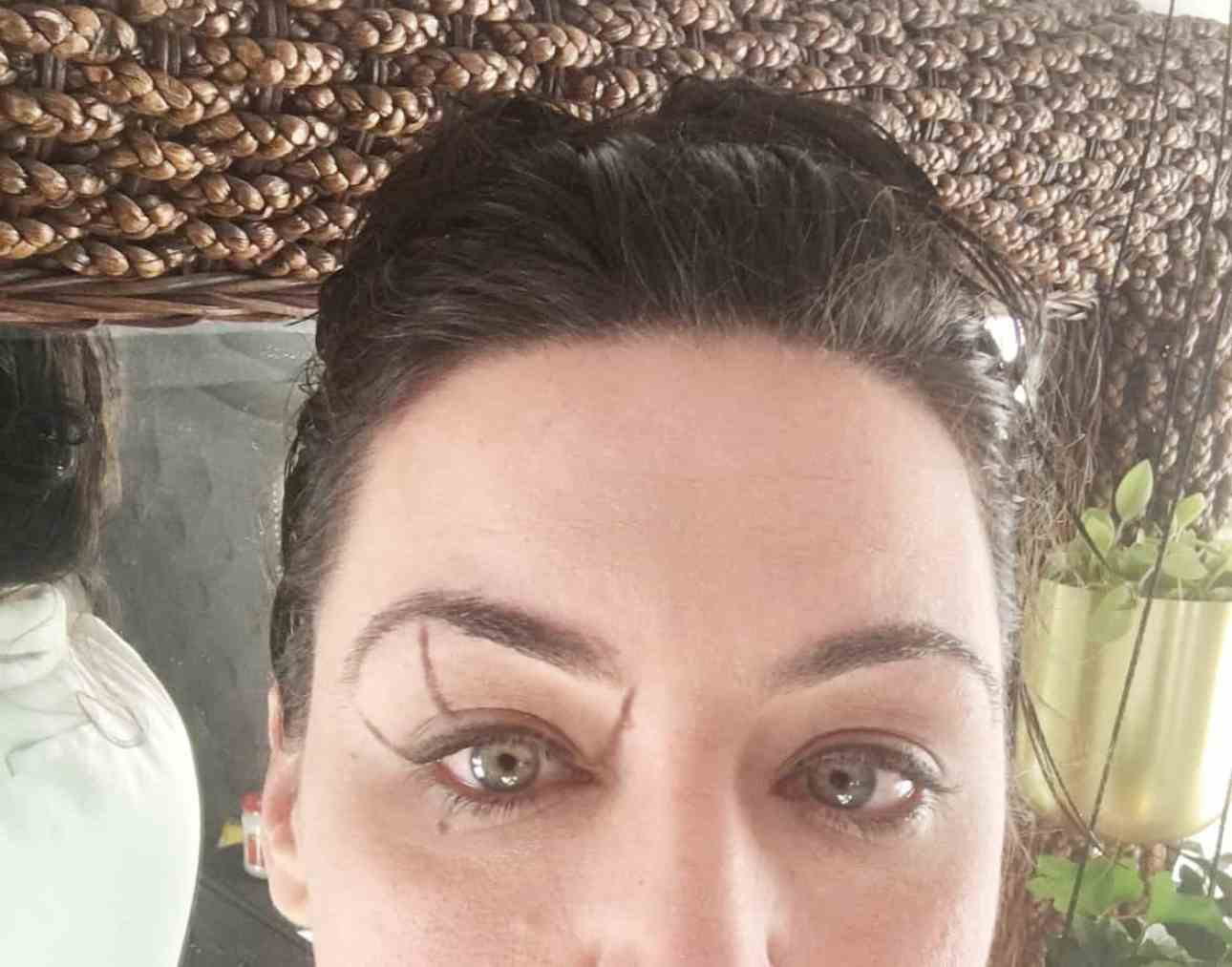 Drawing the lines to shape your brows.