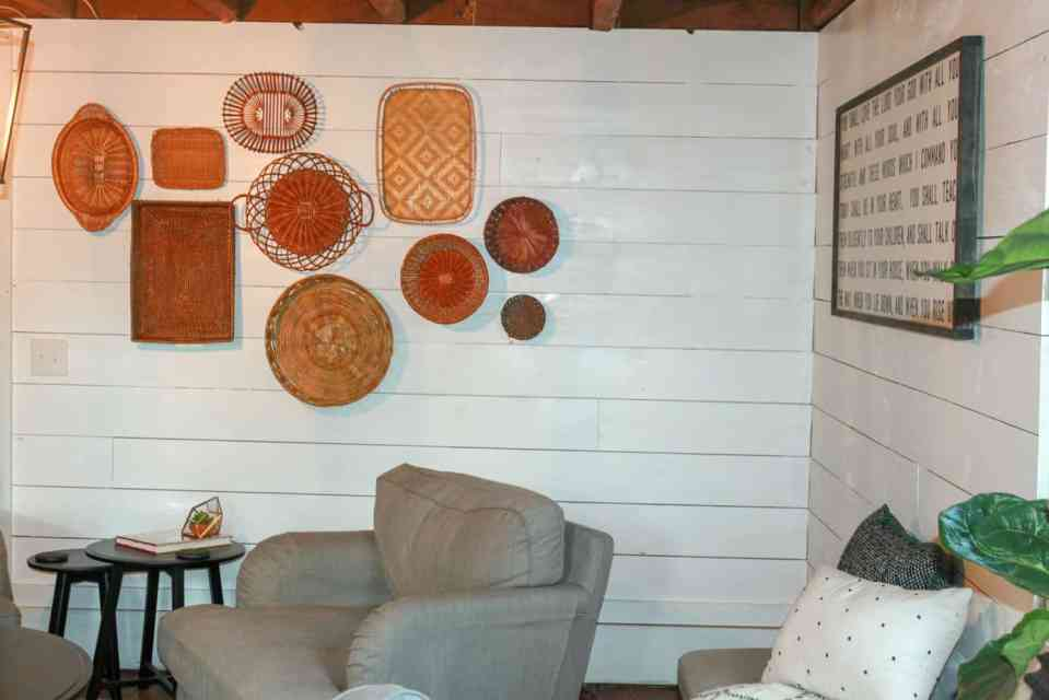 Baskets of various sizes and shapes on the wall.