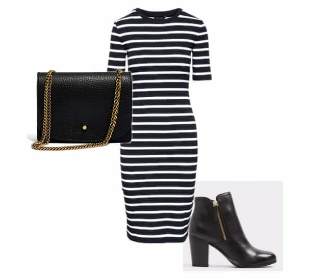 A black and white striped dress, with a black clutch that has a gold chain and a black bootie.