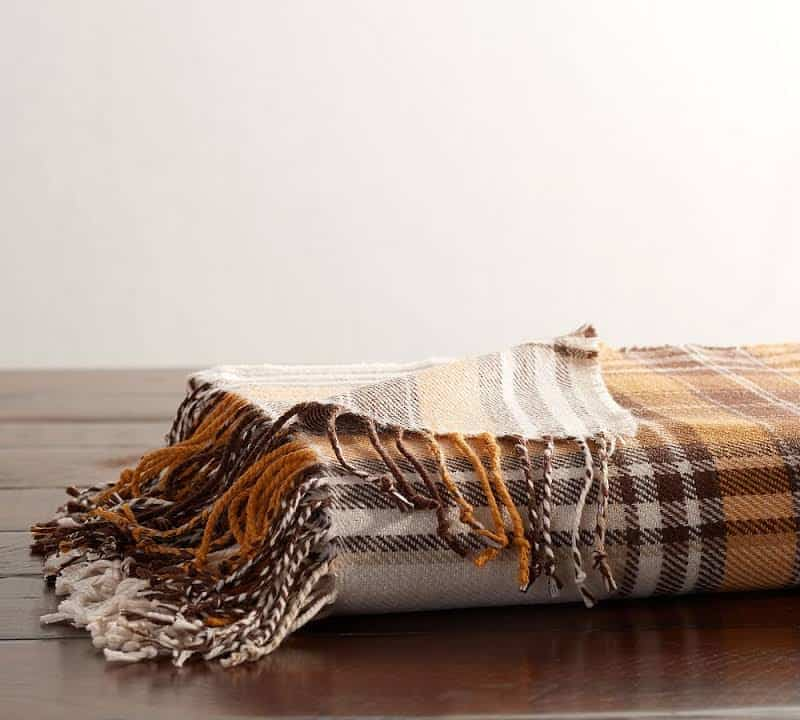 A brown, gold and white flannel throw.