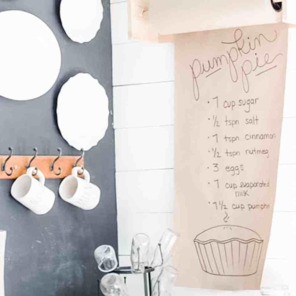 A pumpkin pie scroll recipe on the wall.
