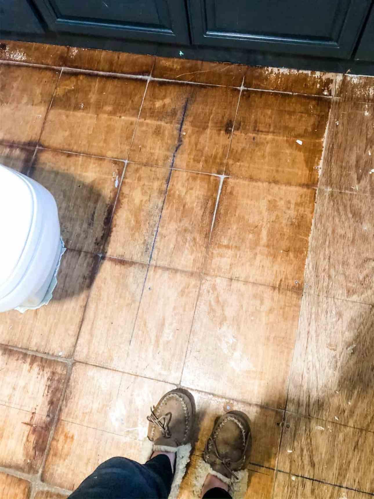 Wooden bathroom floor and slippers.
