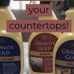 three bottles of countertop cleaner