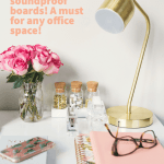 gold lamp on desk with glasses and pink flowers
