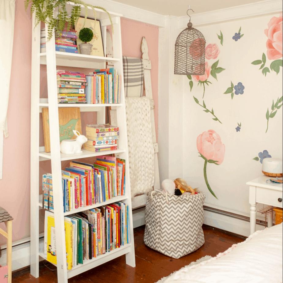 white bookshelf with books and blanket ladder