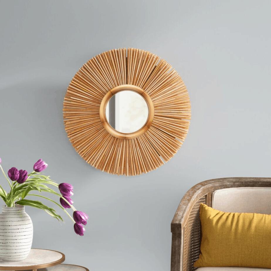 Round sunbeam mirror on the wall.