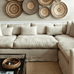 Woven baskets on wall over a linen sectional sofa