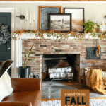 brick fireplace with fall garland on mantel