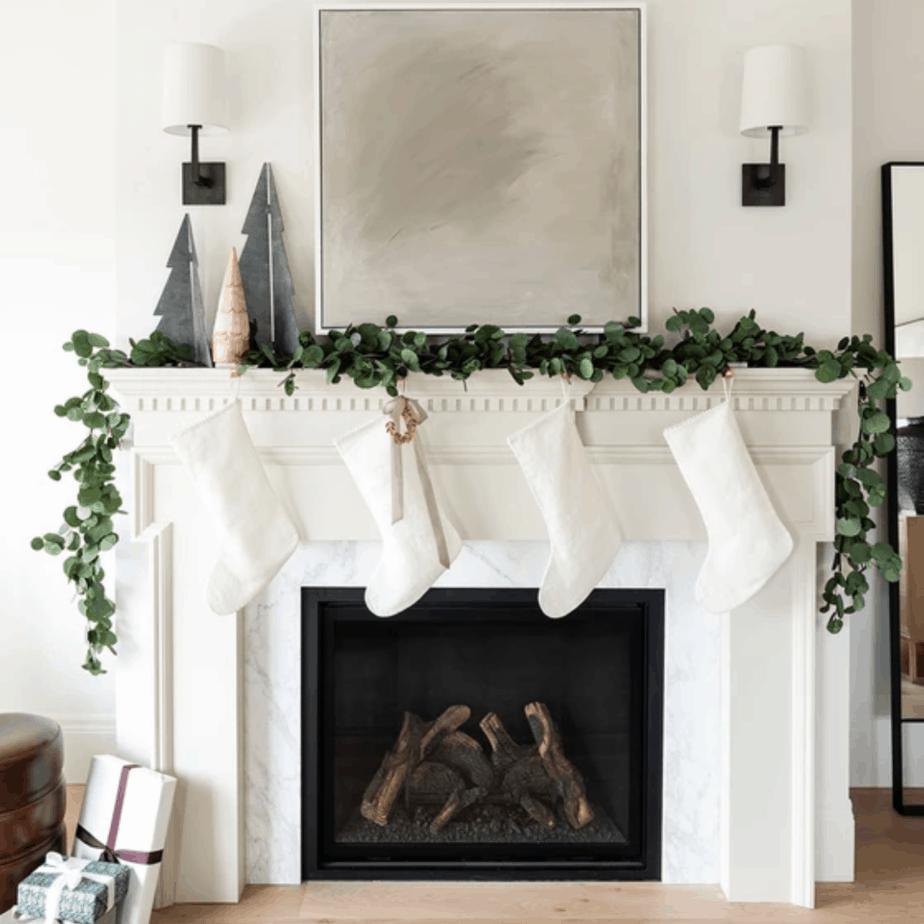 pre-lit eucalyptus Christmas garland on mantel