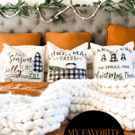 rust colored bedding with white and buffalo check Christmas pillows on bed