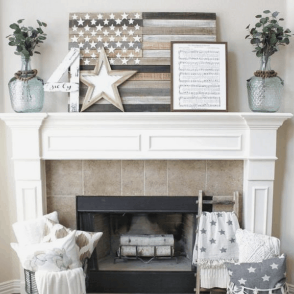 flag wall art and star on top of a white mantel